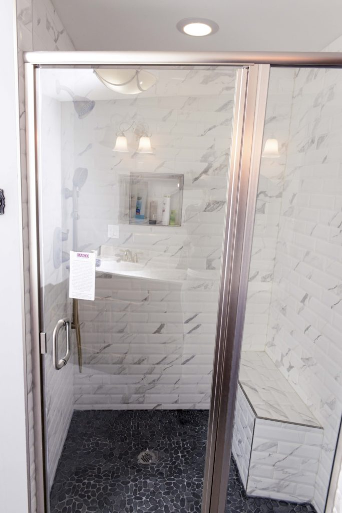 Bathroom, Sink, Toilet, Mirror, Winodw, Door, Floor, Shower, Shower Light, After Remodeling A Bathroom. Work done by General Contractors of Domus Novus LLC. Mydomusnovus projects. Experts in renovations and new constructions. Bench New Window Installation by Domus Novus mydomusnovus